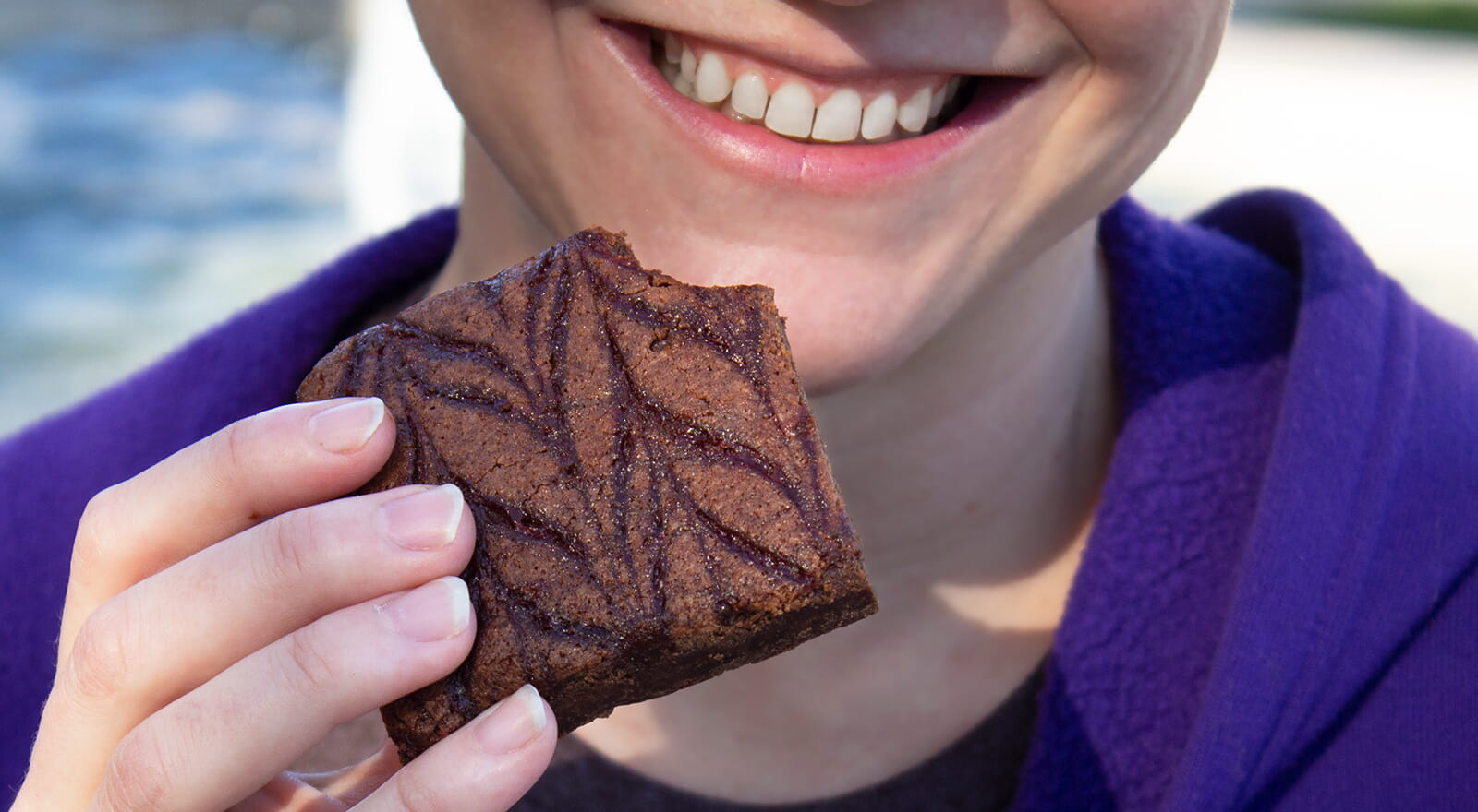 Smiling woman with a brownie