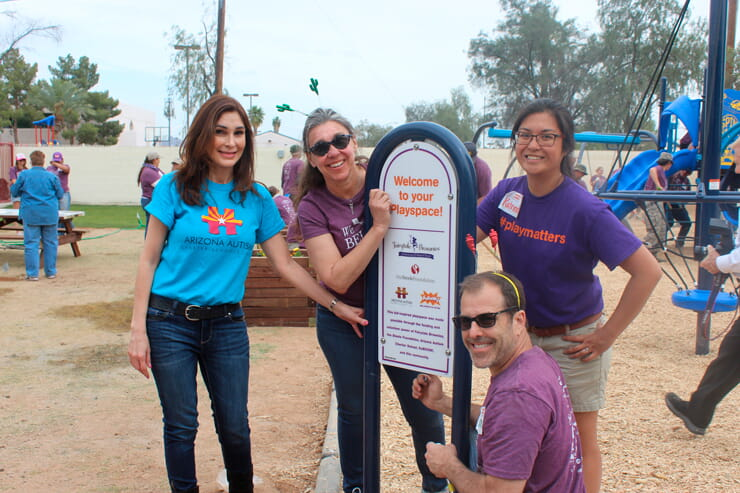Group standing by KABOOM sign