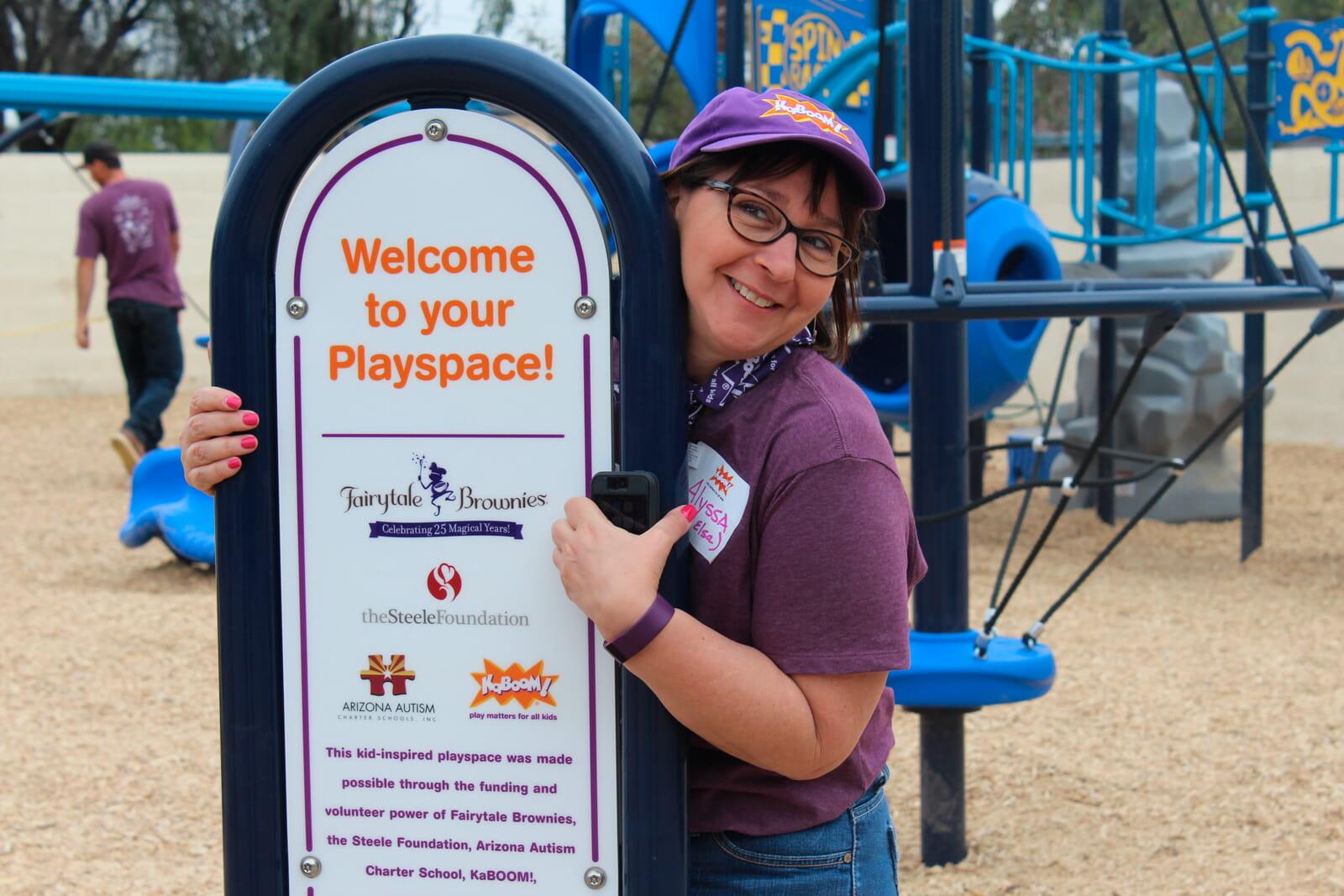 Volunteer with KABOOM sign